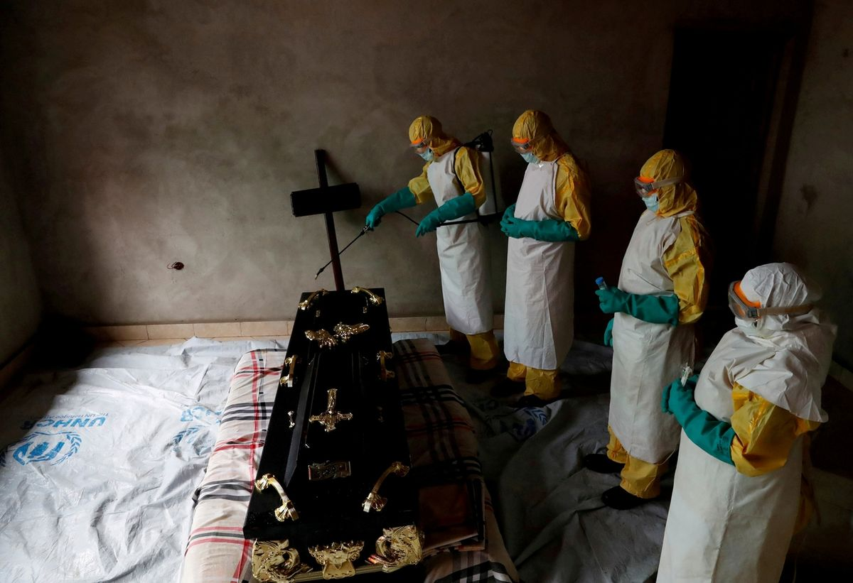 Pictures of the YearA healthcare worker sprays a room during a funeral of Kavugho Cindi Dorcas who is suspected of dying of Ebola in Beni, North Kivu Province of Democratic Republic of Congo, December 9, 2018.
