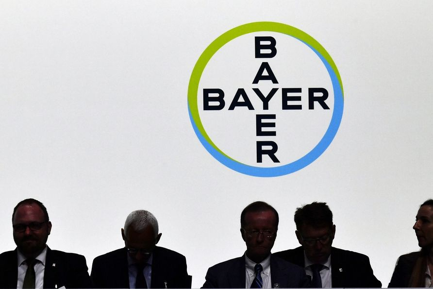 In this May 25, 2018 file photo members of the supervisory board sit in front of the company logo during the annual shareholders meeting of Bayer AG in Bonn, Germany.